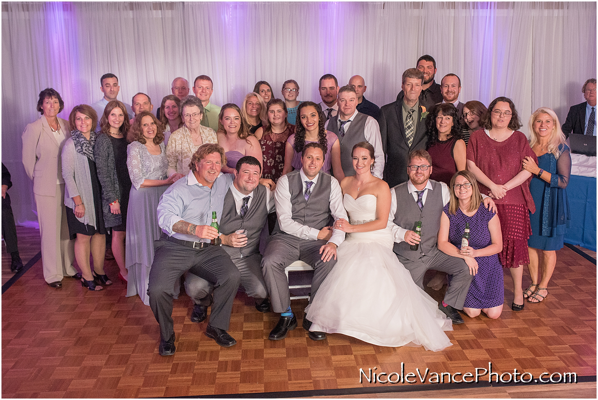 Extended family photo during the wedding reception at the Brownstone.