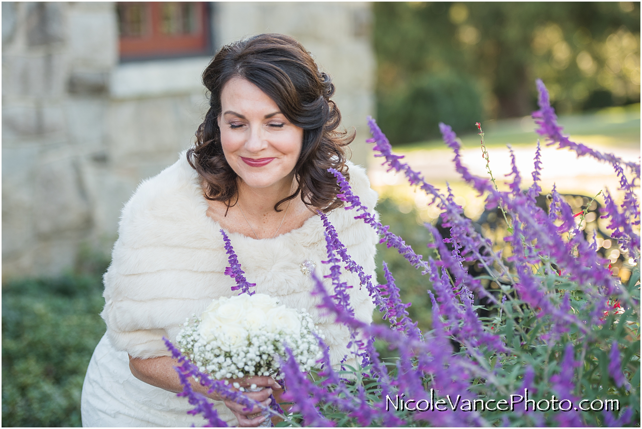 I love this candid photo of the bride smelling the flowers in the garden at Maymont Park in Richmond Virginia.
