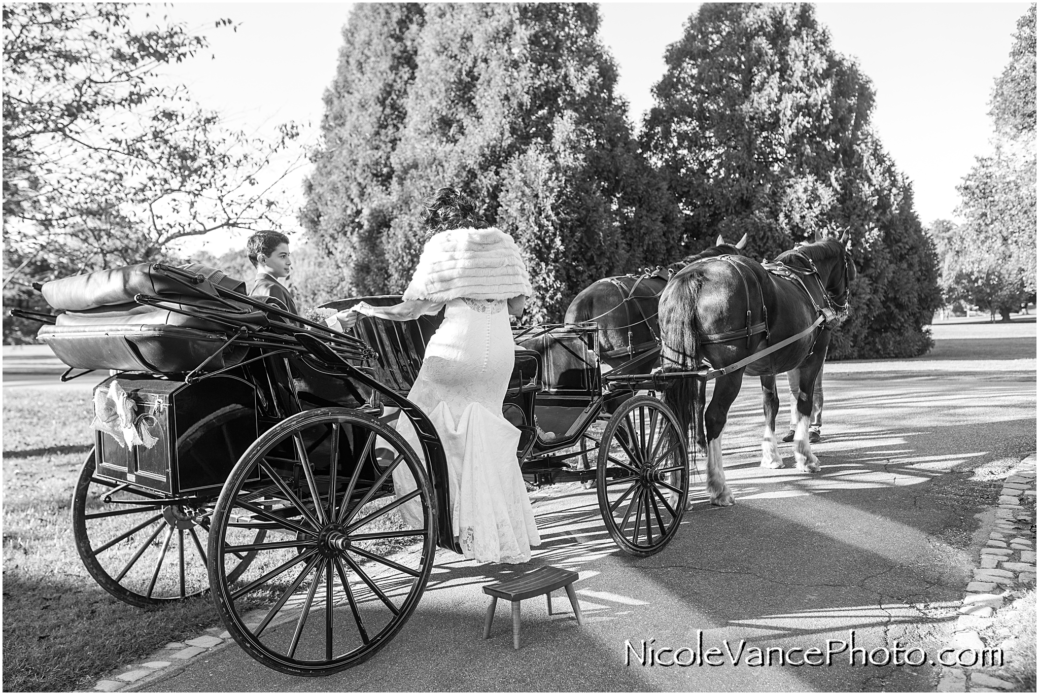 The bride boards her horse drawn carriage at Maymont Park which will take her to the ceremony site across the park.