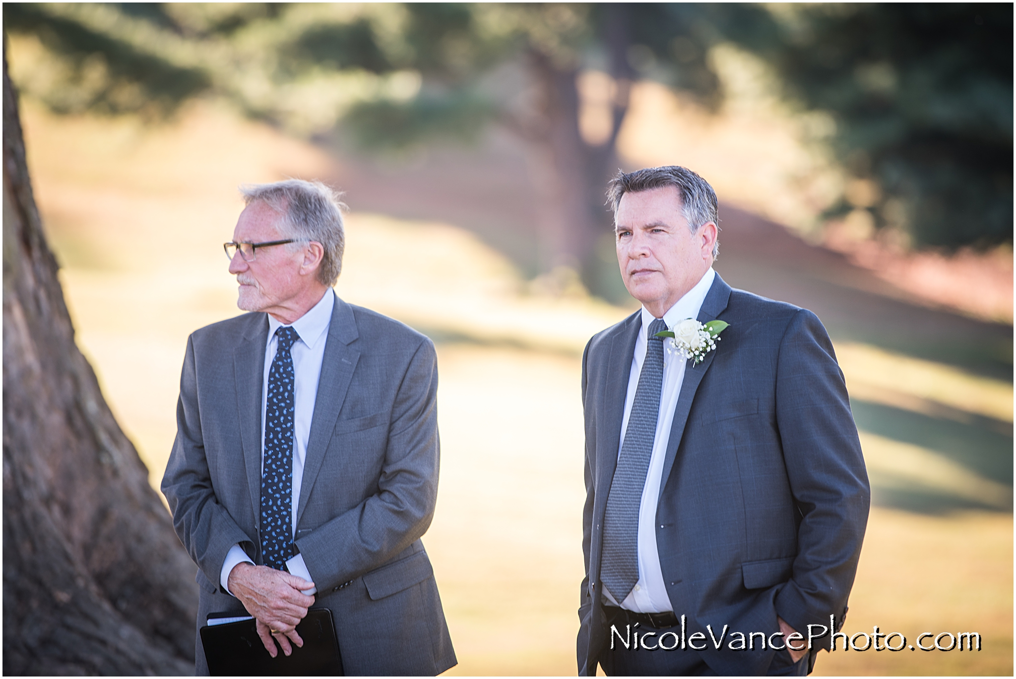 The groom watches as the horse drawn carriage arrives at their Maymont Park wedding ceremony.
