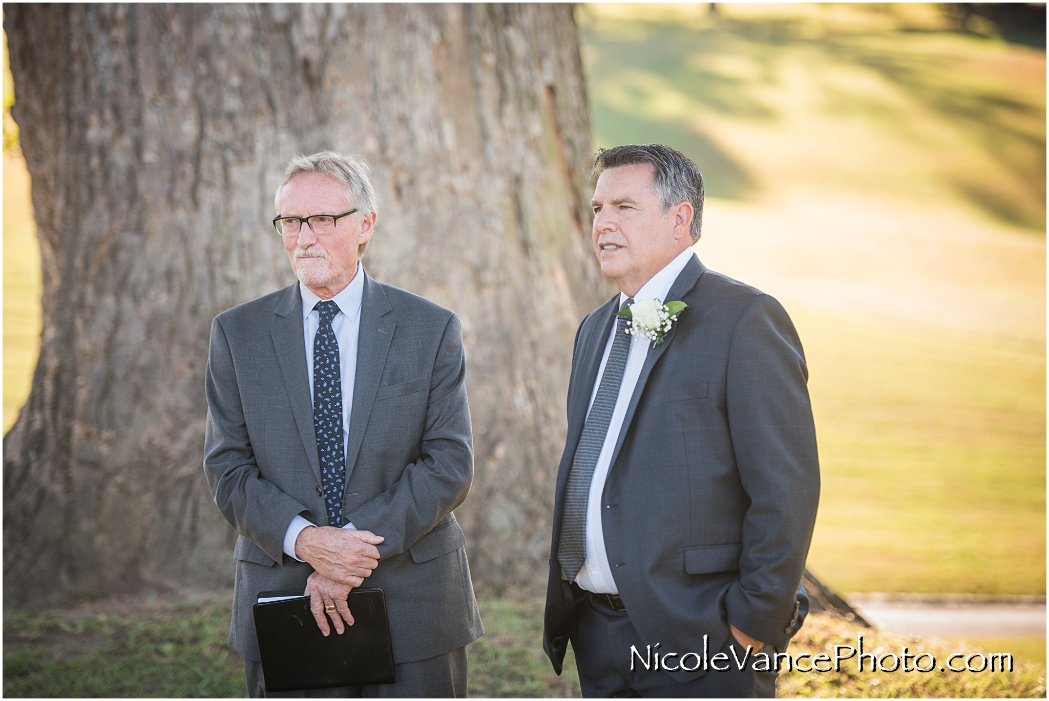 The groom sees his bride for the first time at their ceremony at Maymont Park in Richmond, Virginia.