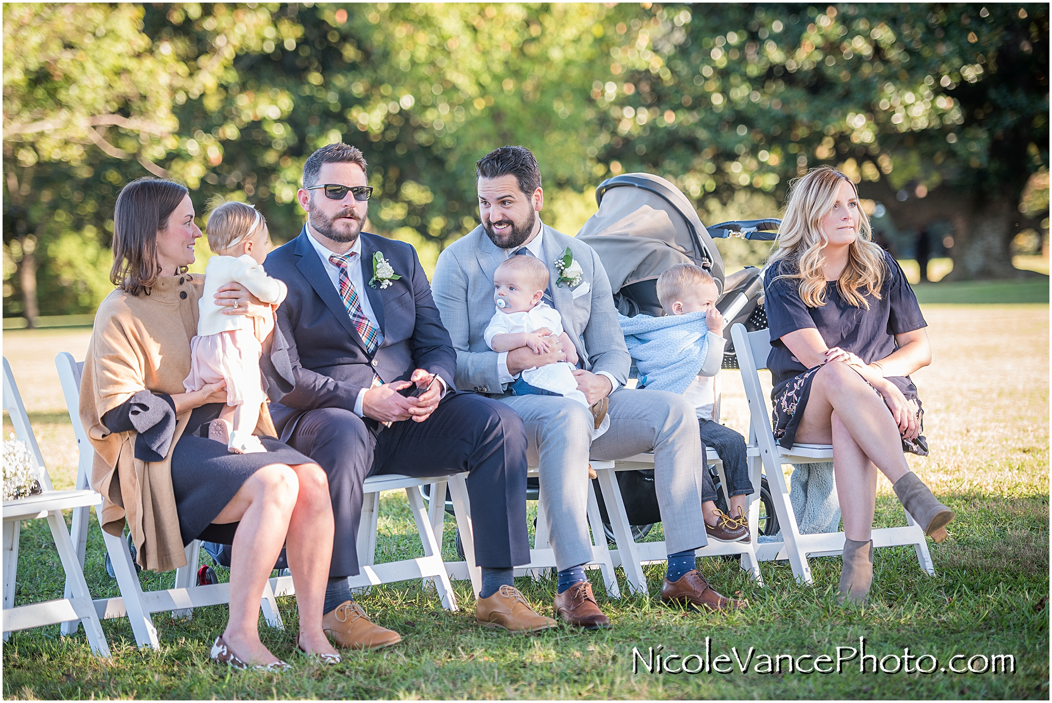 Guests enjoy the wedding ceremony with their young children at Maymont Park.