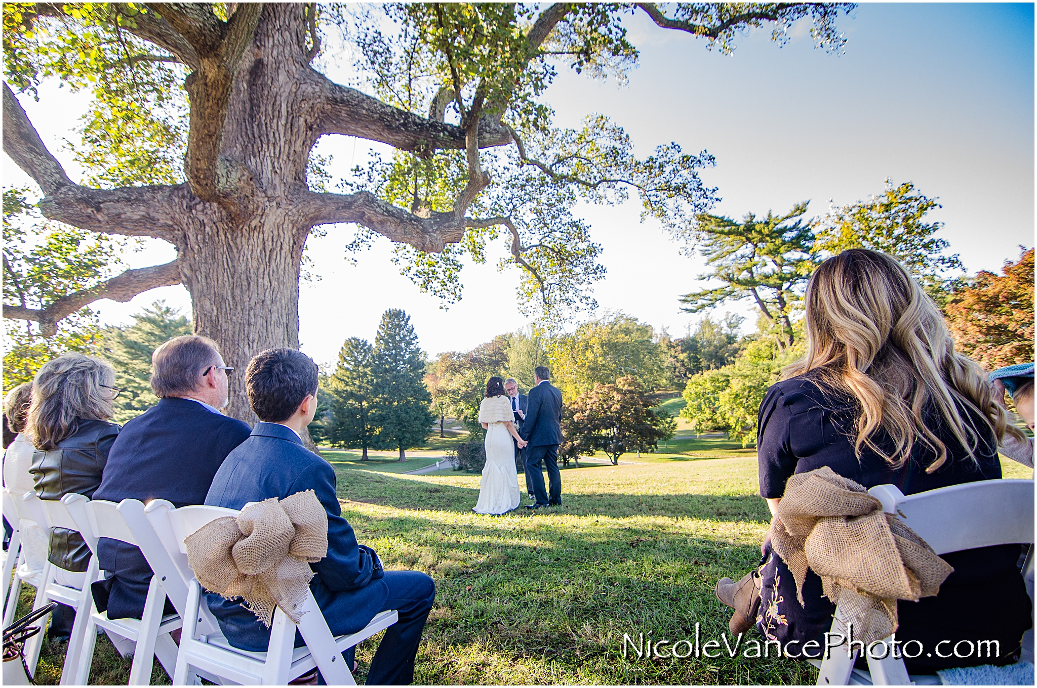 Guests enjoy the wedding ceremony at Maymont Park in Richmond, Virginia.