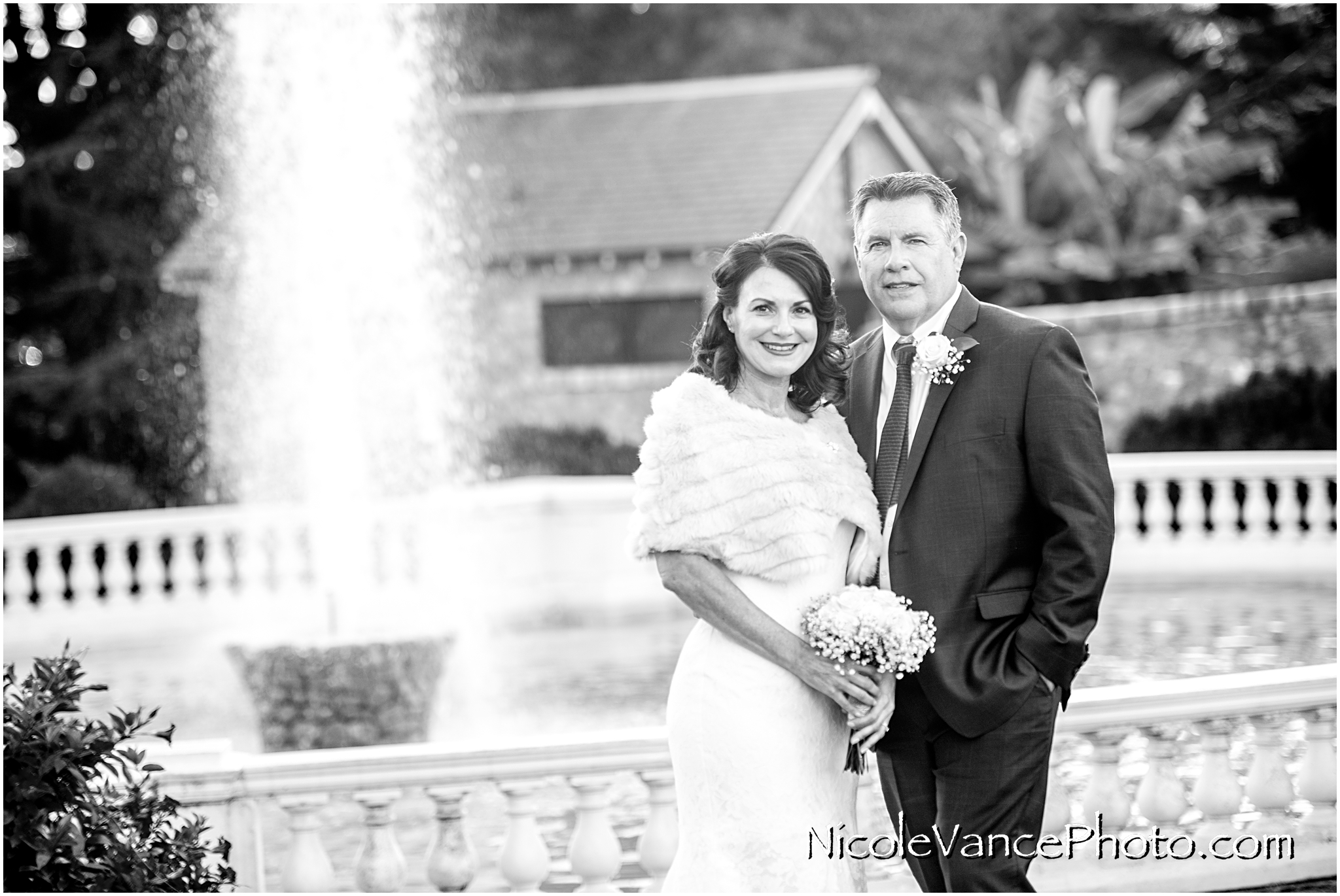 The bride and groom pose by the fountain at Maymont Park in Richmond, VA.